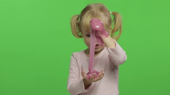 Kid Playing with Hand Made Toy Slime. Child Having Fun Making Pink Slime