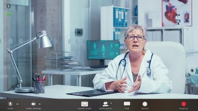 Doctor Making an Online Consultation Footage with Software Overlay