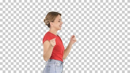 Young woman in red t-shirt jeans dancing and walking,