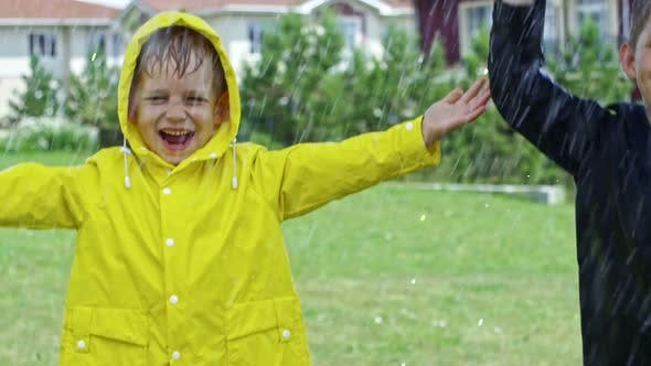 Thumbnail for Happy Boys Jumping in Rain