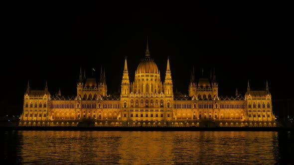 Thumbnail for Budapest by the night and river Danube scene with Hungarian national parliament 4K 3840X2160 UltraHD