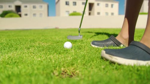 Close Up of the Golf Stick Hitting a Golf Ball