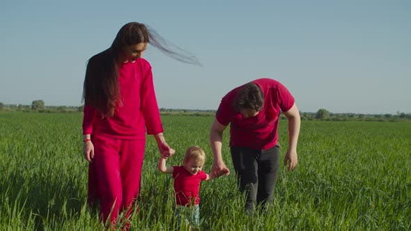 Thumbnail for Carefree Family with Baby Relaxing in Countryside