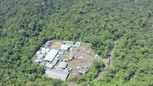 Top view of an oil pumping platform in the Amazon rainforest