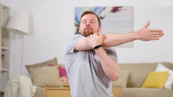 Thumbnail for Man Stretching Shoulders after Training at Home