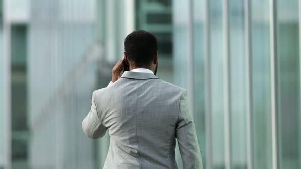 Thumbnail for Back View of African American Businessman Talking on Smartphone