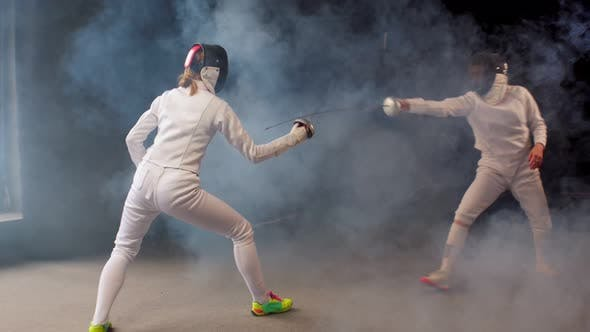 Thumbnail for Two Young Women Fencers Having a Dynamic Training Duel in the Studio
