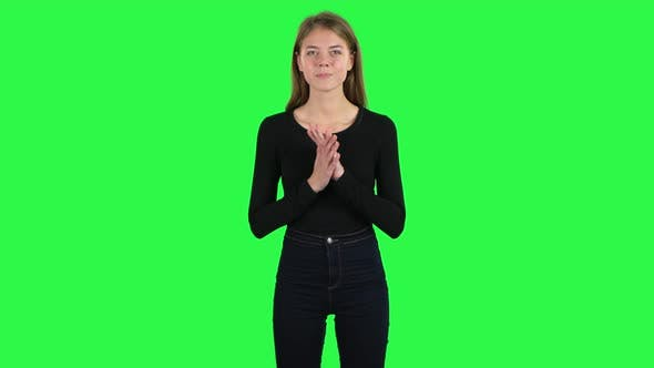 Cover Image for Young Woman Looking at Camera with Anticipation, Then Very Upset . Green Screen