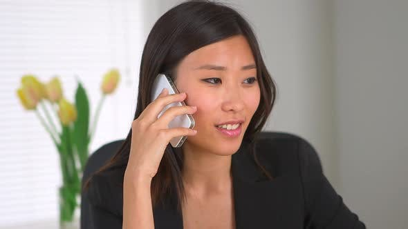 Asian businesswoman talking on phone