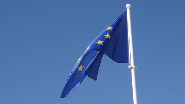 Thumbnail for Fabric of European Union recognizable flag waving in front of blue sky slow-mo 1080p FullHD footage