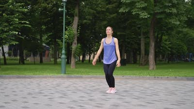 Slow Motion Woman Jumping in Park