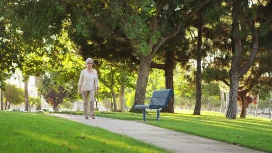 Thumbnail for Grandma walking at the park