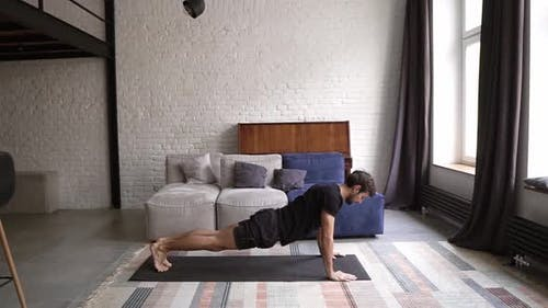 Young Healthy Man Practice Yoga on Mat Stretching Back