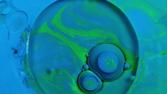 Blue liquid paint bubbles united in one