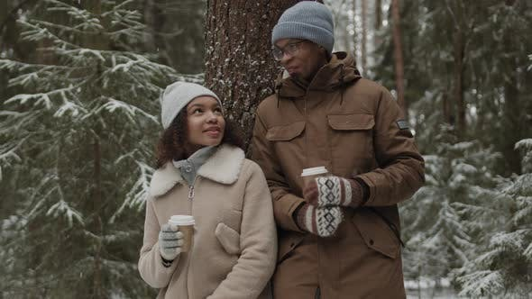 Thumbnail for Couple Walking in Woods and Drinking Coffee