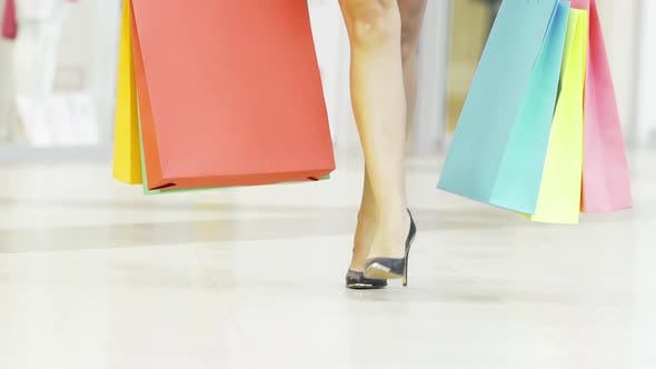 Gorgeous Female Legs in Highheels Walking in Shopping Mall
