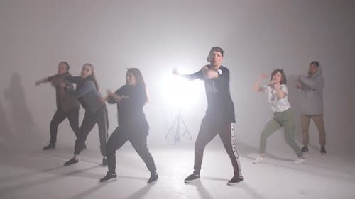 Young Group of Six Adult People Practice Dancing