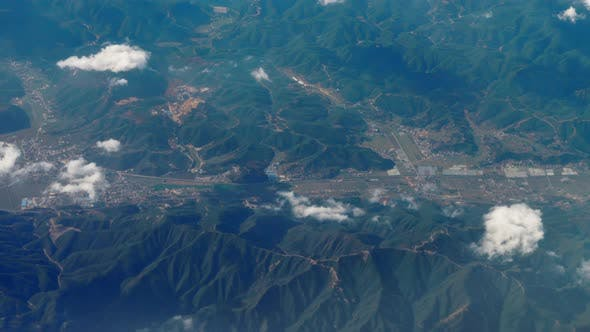 Thumbnail for Beautiful View Through Airplane Window, Airplane Flying Above City in Mountains