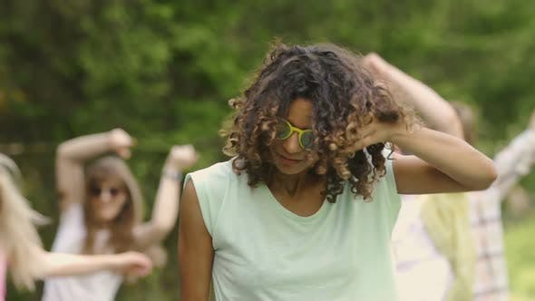 Thumbnail for Flirty Mixed Race Female Hanging Out at Party in Park, Summer Weekend, Youth