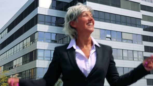 Thumbnail for Happy Business Middle Age Woman Dances - Company Building in the Background