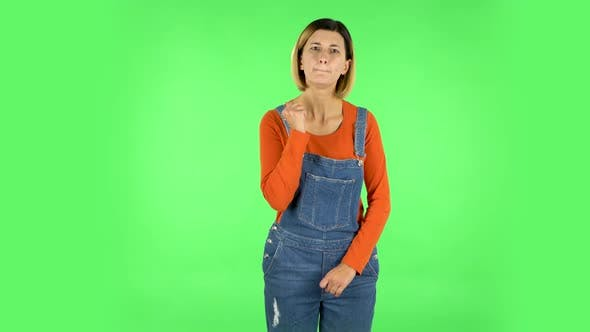 Thumbnail for Girl Threatens with a Fist. Green Screen