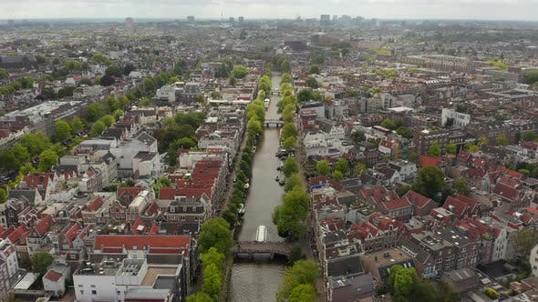 Thumbnail for Typical Amsterdam Canal Wide View Establisher, Aerial Forward, Cloudy