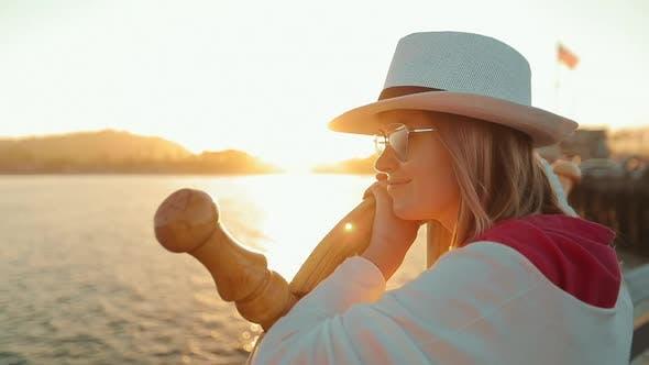 Thumbnail for Close Up Portrait of Beautiful Woman Enjoying Peaceful Sunset at Ocean Pier, USA