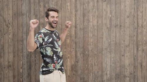 Laughing Guy In T-Shirt Turning
