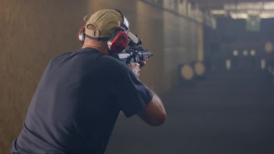 Thumbnail for Unrecognizable Man Practicing in Shooting Range