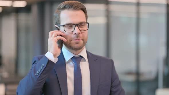 Portrait of Businessman Talking on Phone