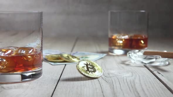 Thumbnail for Glasses of Whiskey and Spinning Bitcoin