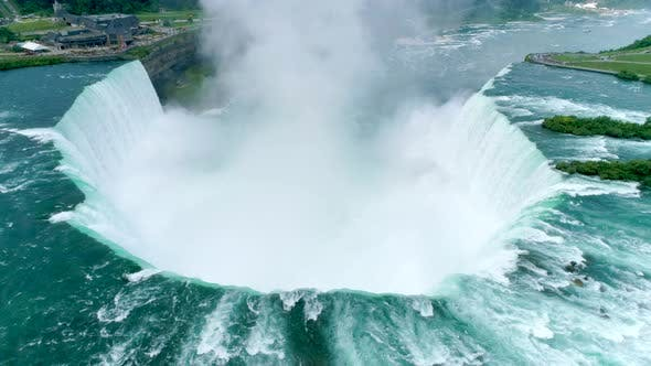 Thumbnail for Drone Shot of Gigantic Rush of Water Over the Falls