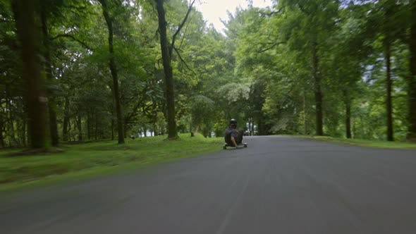 Thumbnail for Riding skateboard in park