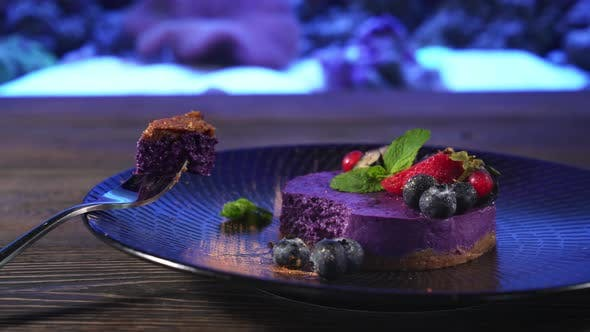 Thumbnail for Piece of Blueberry Cheesecake on Fork Near Aquarium.