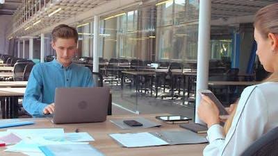 Millennials Sits at Workspace