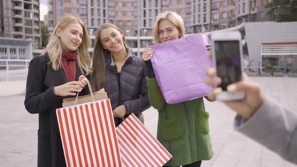 Thumbnail for Caucasian Woman Taking Photos of Her Three Friends with Shopping Bags