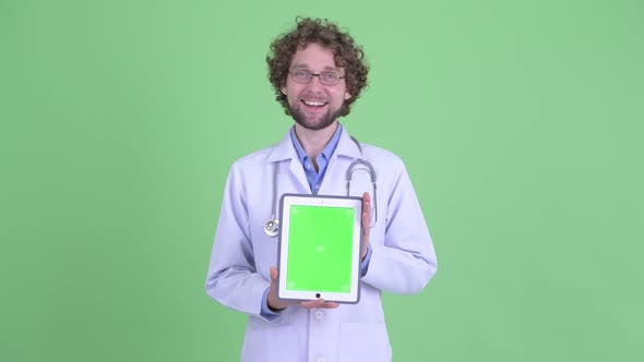 Thumbnail for Happy Young Bearded Man Doctor Showing Digital Tablet