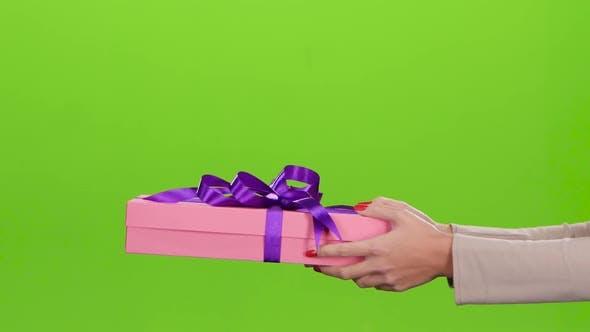 Thumbnail for Gift Box. Girl Gives a Man Pink Box. Close Up