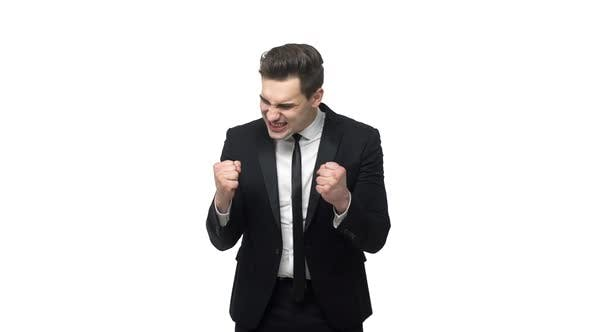 Slow Motion Handsome Young Businessman Doing Victory Gesture About Successful Achievement. Isolated