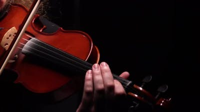 Detailed Footage of a Violinist Playing a Classical Wooden Violin