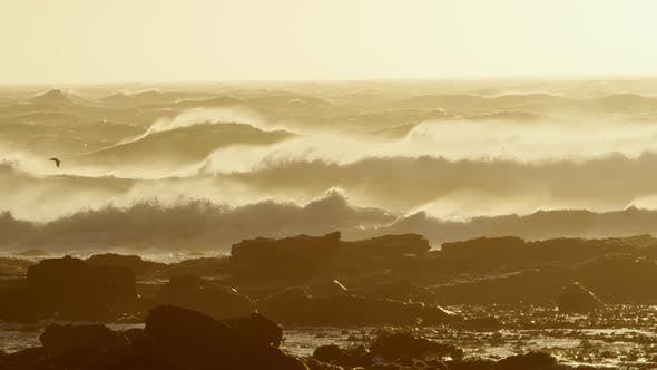 Thumbnail for Big Waves Hitting the Rocky Shore During Sunset