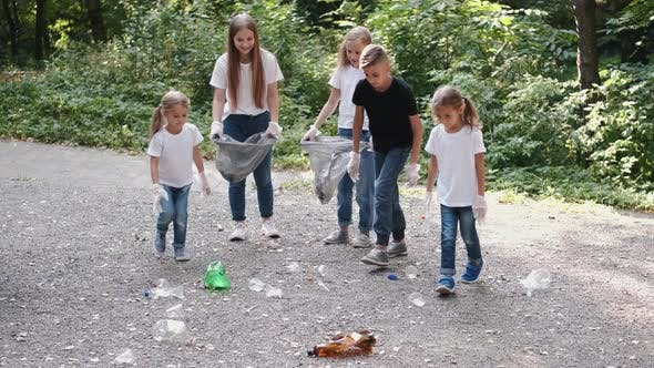 Thumbnail for Group of Kids in Gloves Picking Up the Garbage in City Park