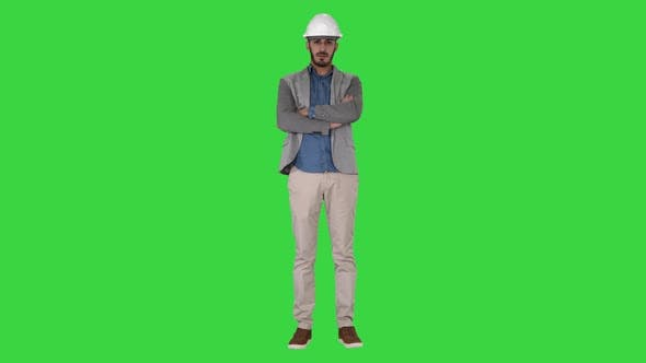 Thumbnail for Confident Construction Engineer Architect Young Man in Helmet with Hands Folded on a Green Screen