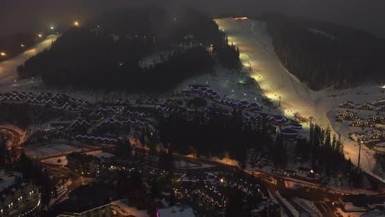 Thumbnail for Night Illumination Cityscape Center Square Mountain Popular Ski Resort. Details of Modern House