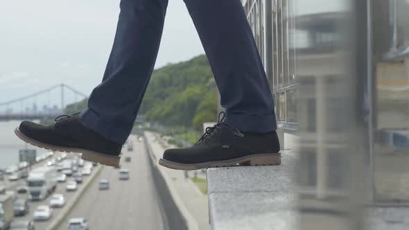Side View Close-up of Unsuccessful Businessman Attempting To Commit Suicide. Unrecognizable Suicidal