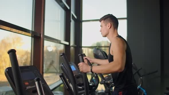 Thumbnail for Man On Elliptical Fitness Equipment.