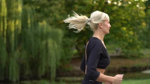Woman Runner Running in the Park, Slow Motion