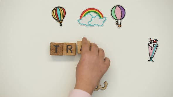 Thumbnail for Travel Word on Wooden Cubes Made by Child, School Excursion, Discovering New