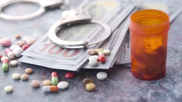 Healthcare Cost Concept with Us Dollar  Container and Pills on Table