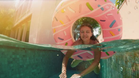 Thumbnail for Young Hipster Millennial Girl in Sprinkled Donut Float at Pool, Smiling Look at Camera. Young Happy
